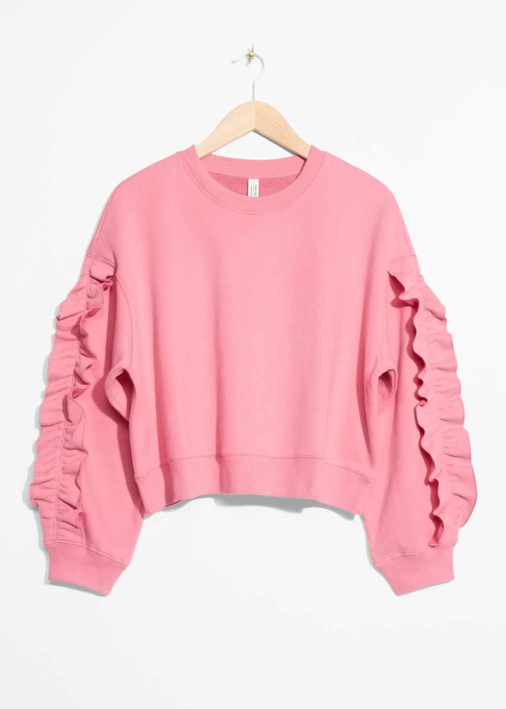 Front image of Stories frill sleeve sweater in pink