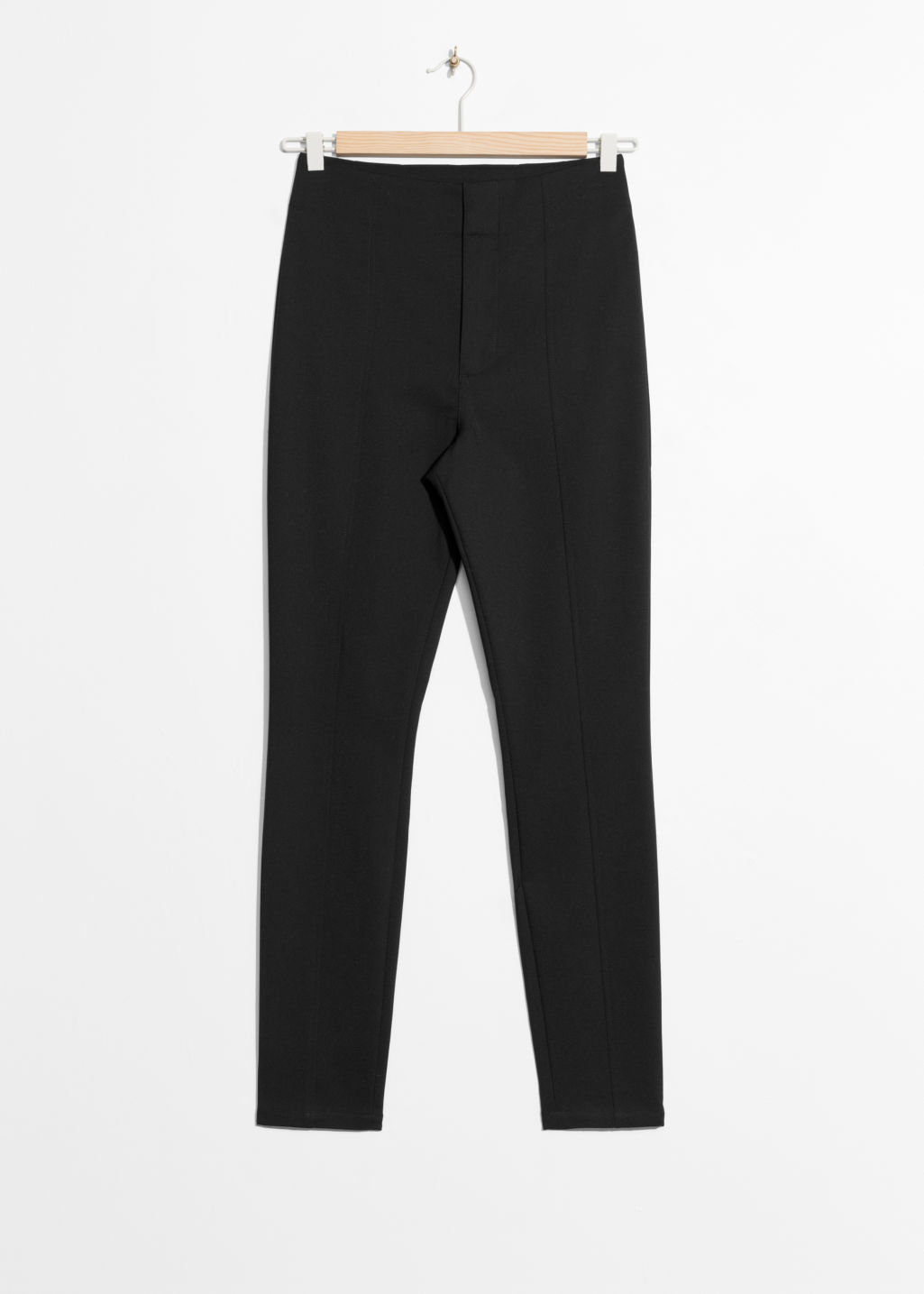 Front image of Stories crease trousers in black