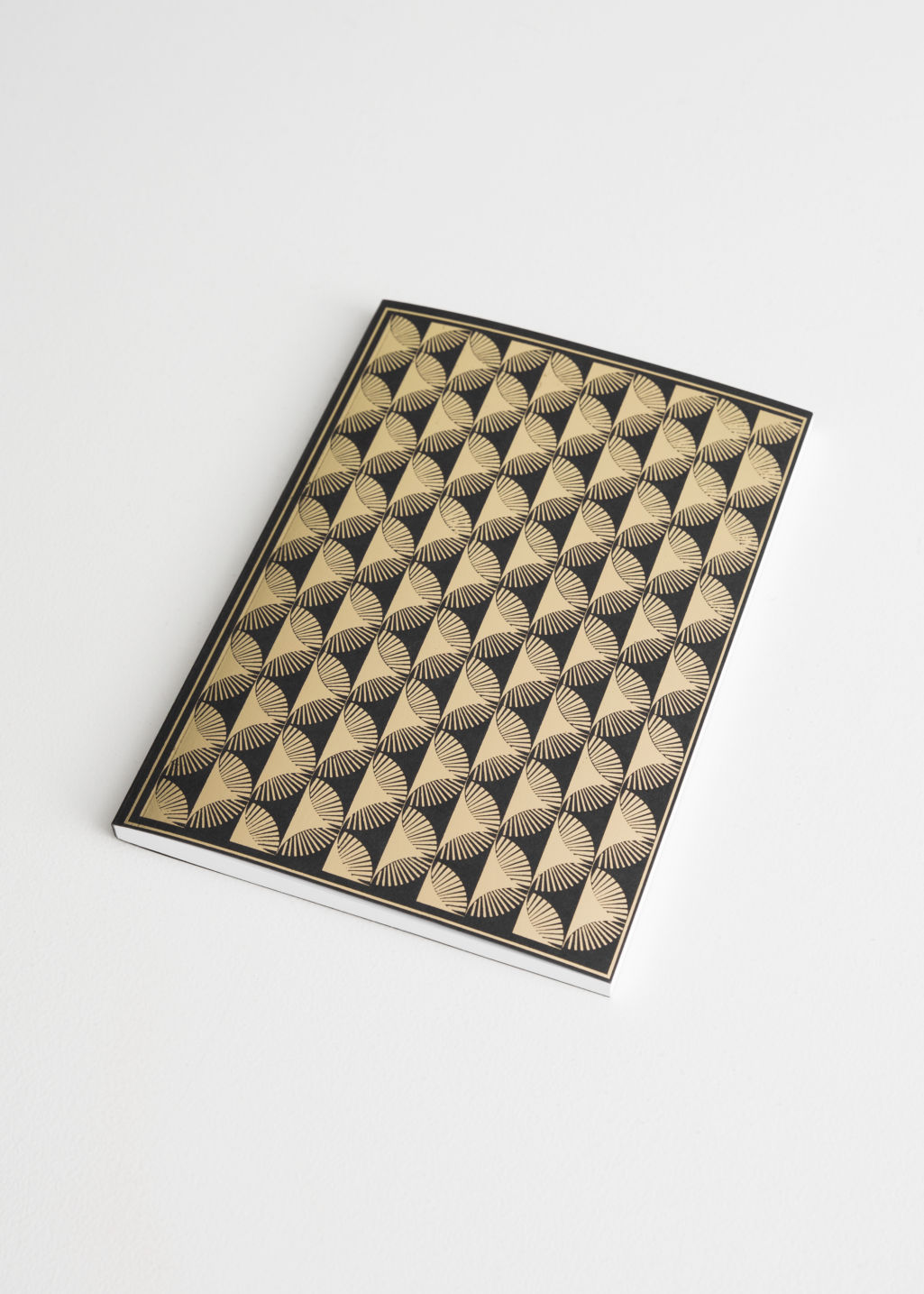 Front image of Stories pyramids a5 notebook in gold