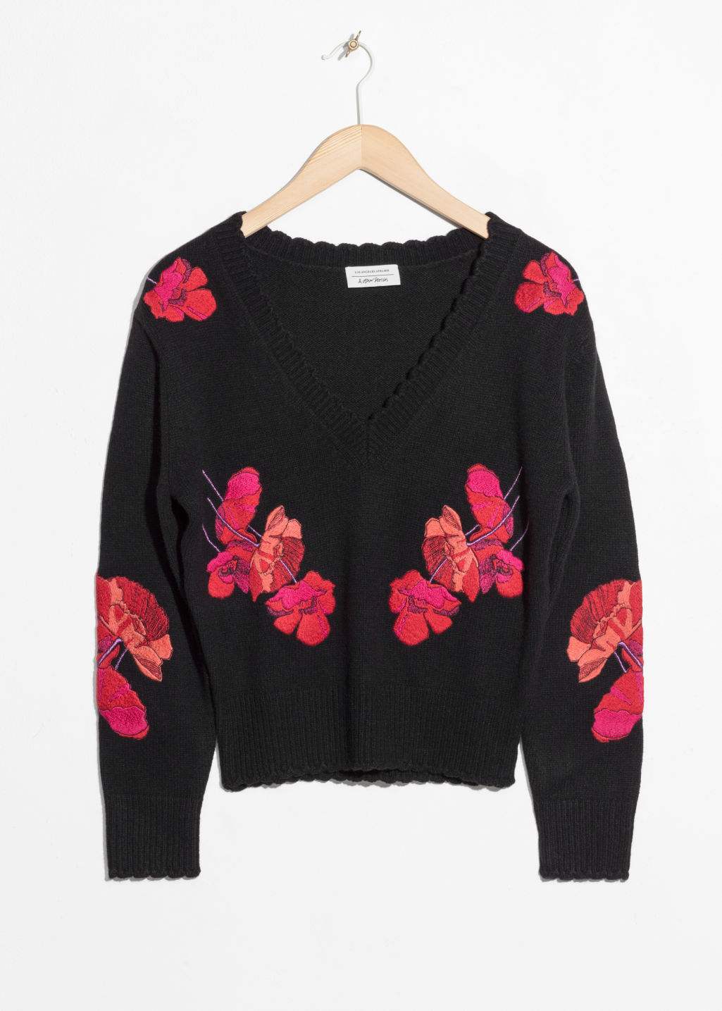 Front image of Stories knit embroidery sweater in black