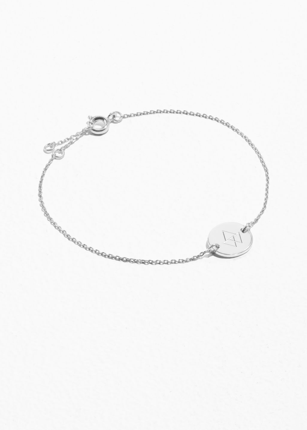 Front image of Stories engraved charm bracelet in silver