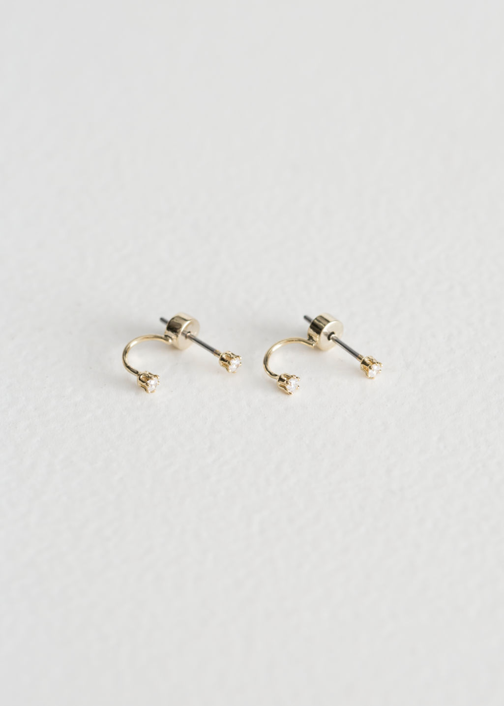 Front image of Stories drop back earrings in gold