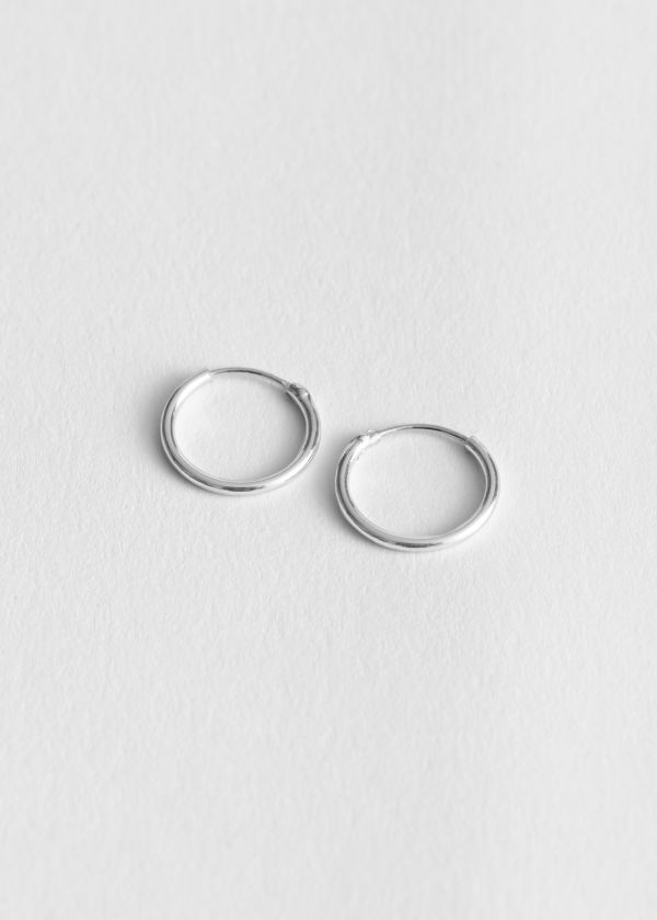 Front image of Stories small hoop earring in silver