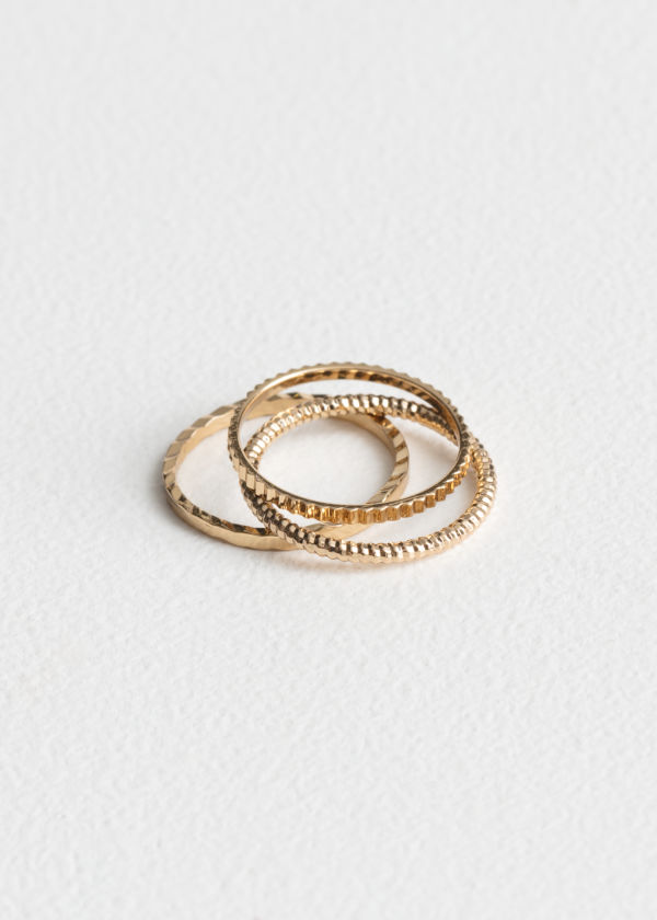 Front image of Stories stack & layer ring set in gold
