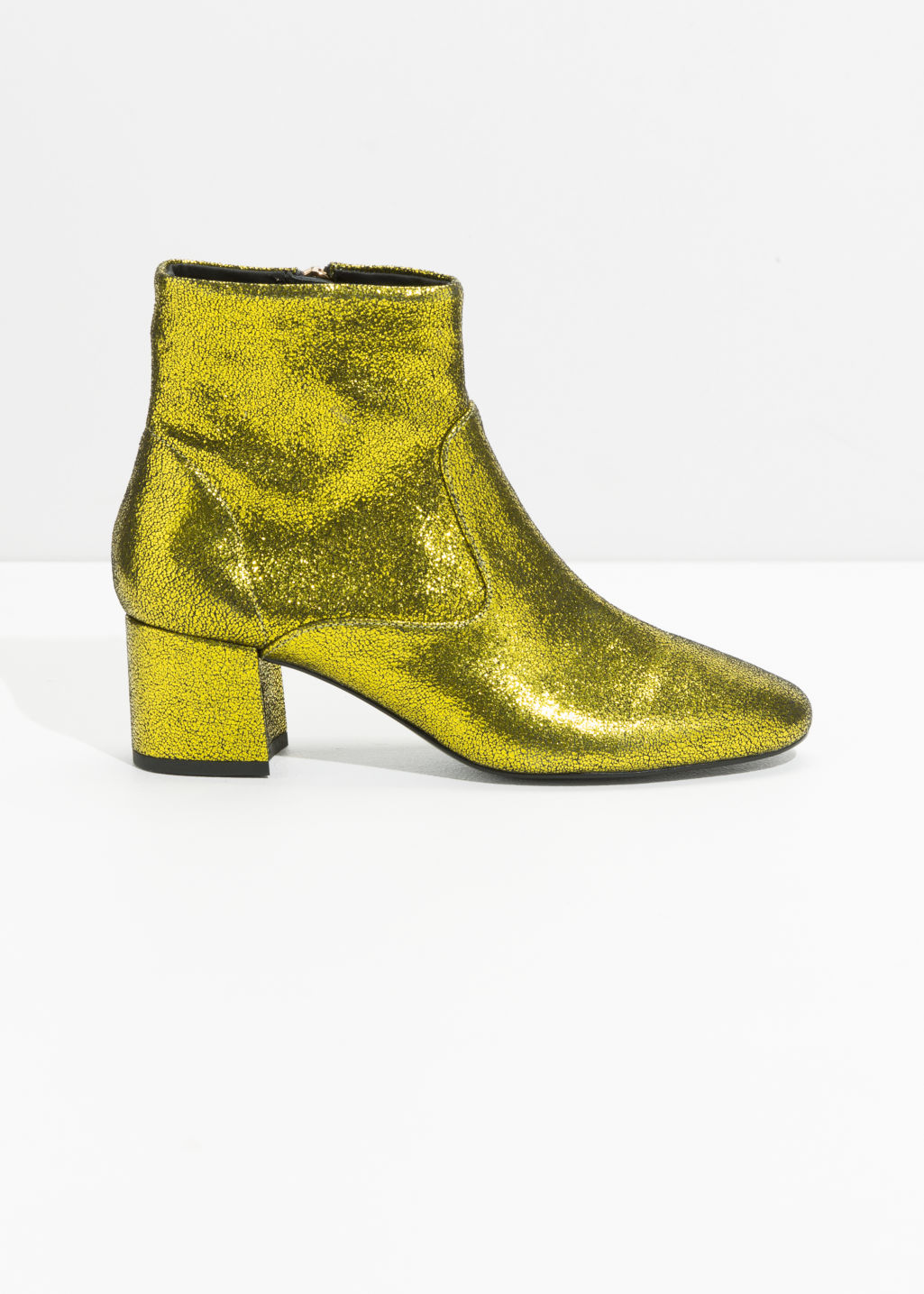 Front image of Stories metallic ankle boots in green