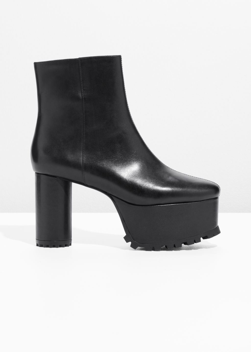 Front image of Stories leather platform boots in black