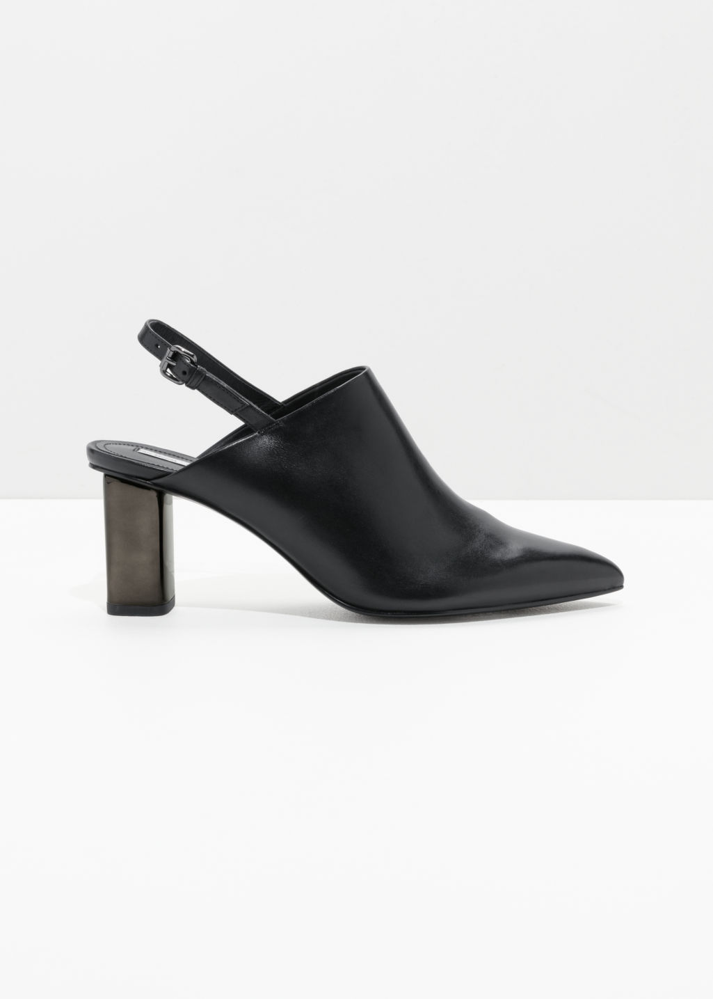 Front image of Stories pointed slingback mules in black