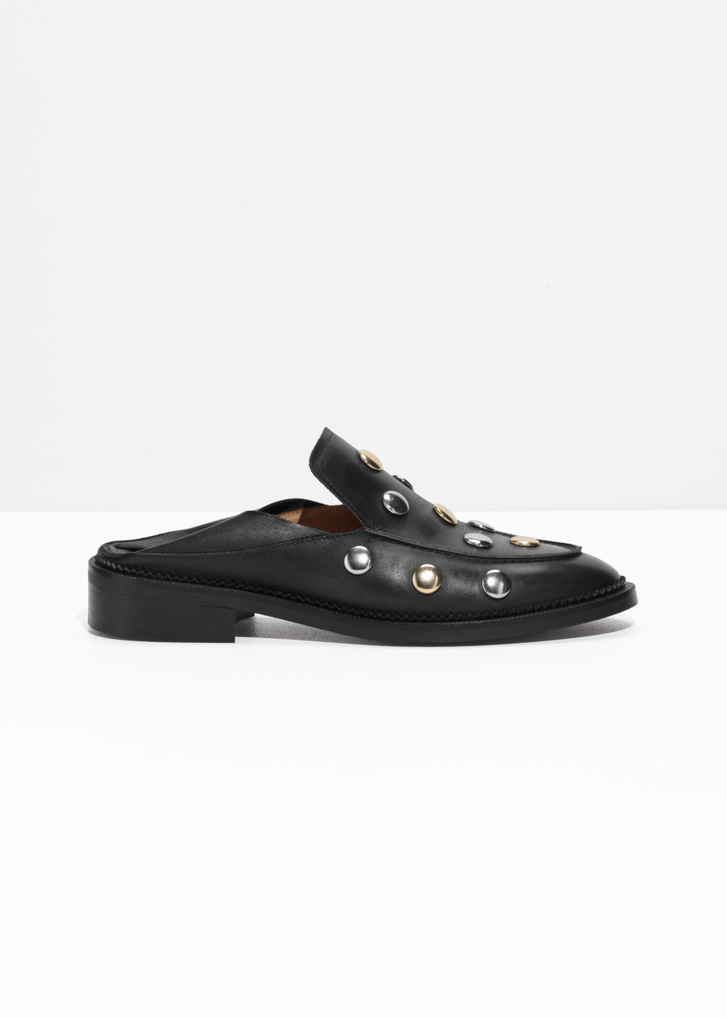 Front image of Stories circle stud loafers in black