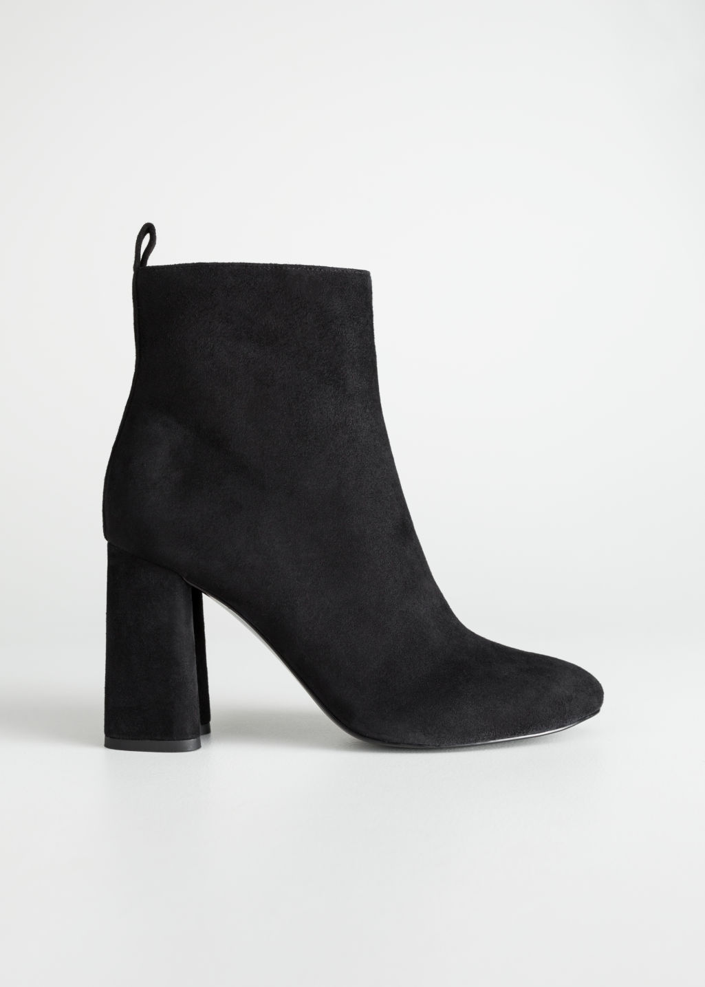 Front image of Stories sculpted heel suede boots in black
