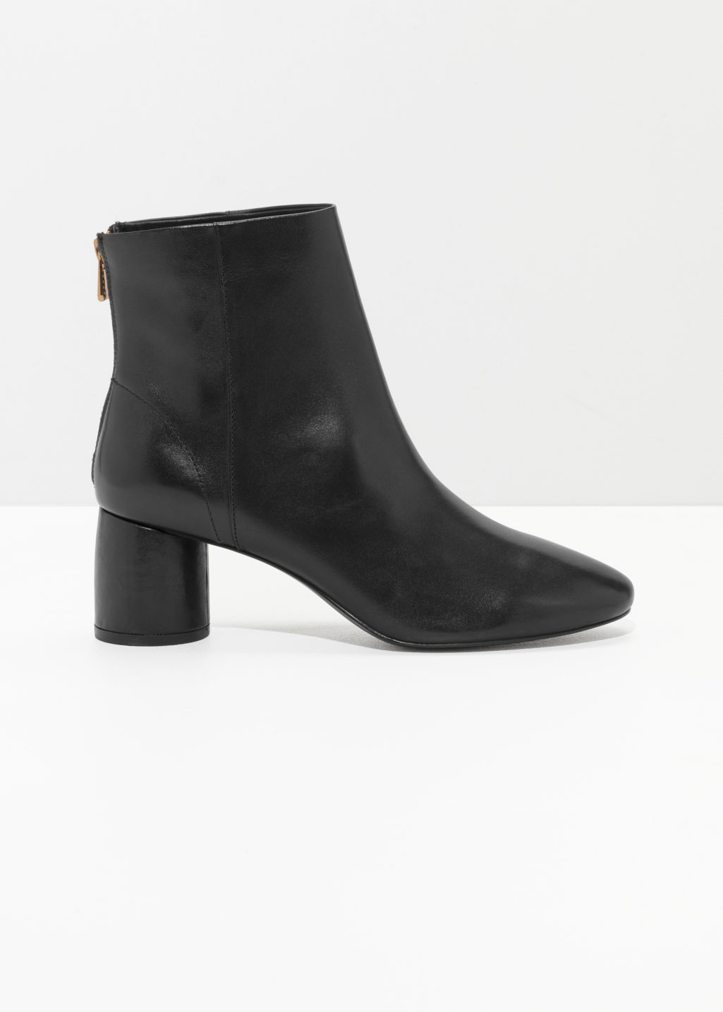 Front image of Stories cylinder heel boots in black