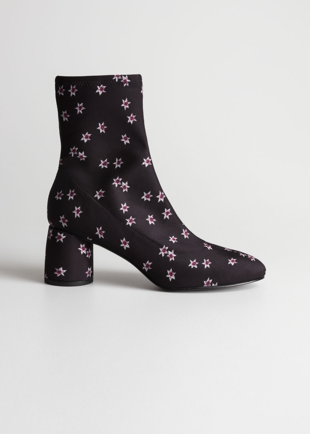 Front image of Stories sock boots in black