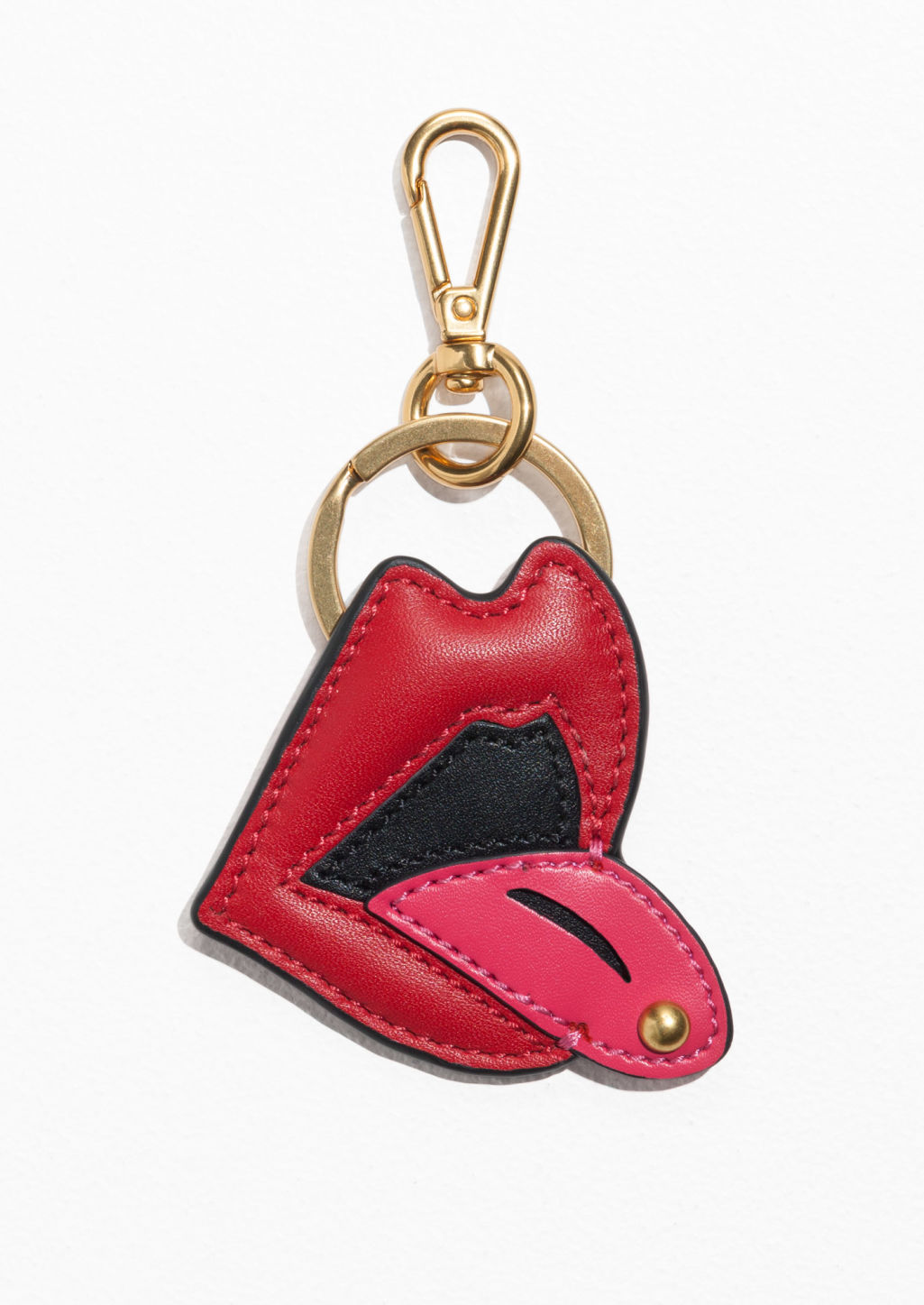 Front image of Stories lip leather keyring in red
