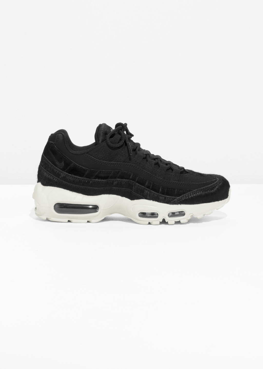 Front image of Stories nike  air max 95 lx in black