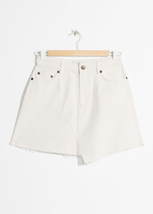 Front image of Stories raw hem two-toned denim skirt in white