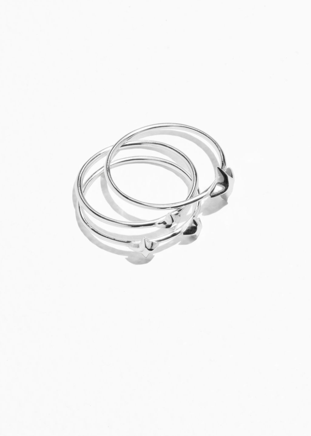 Front image of Stories trio stack star rings in silver