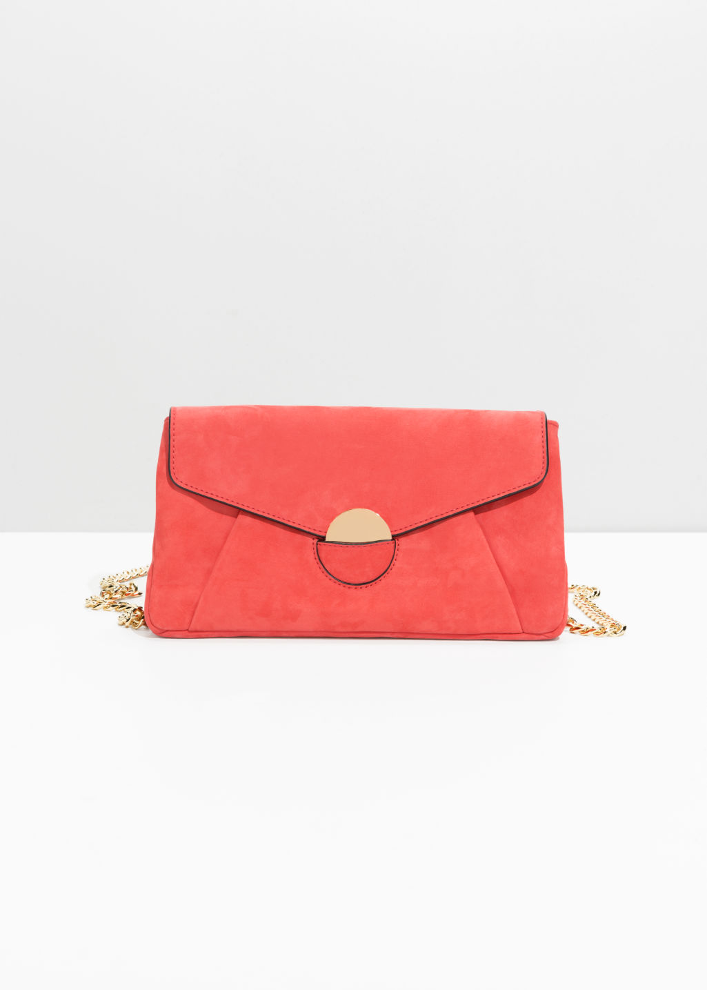 Front image of Stories envelope crossbody bag in red