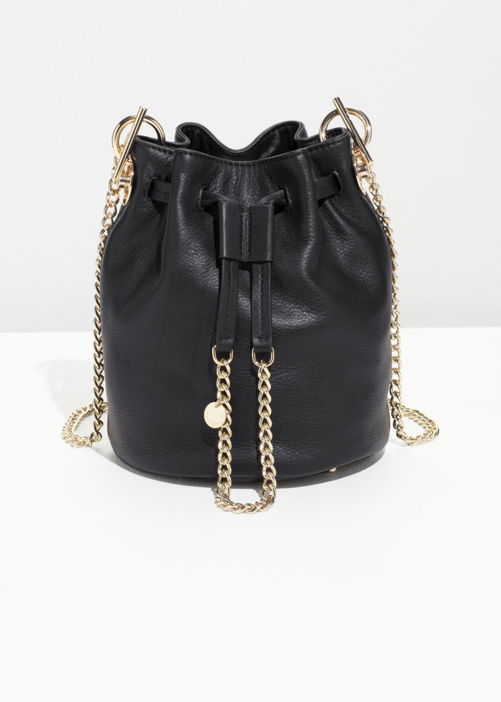 Front image of Stories chain strap bucket bag in black