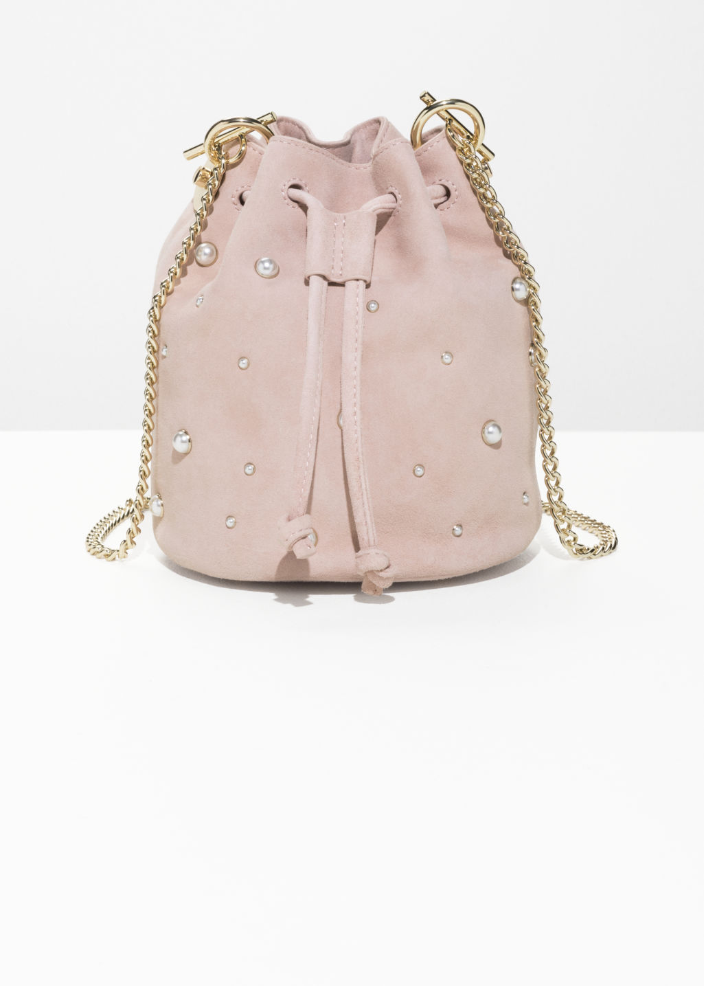 Front image of Stories chain strap bucket bag in pink