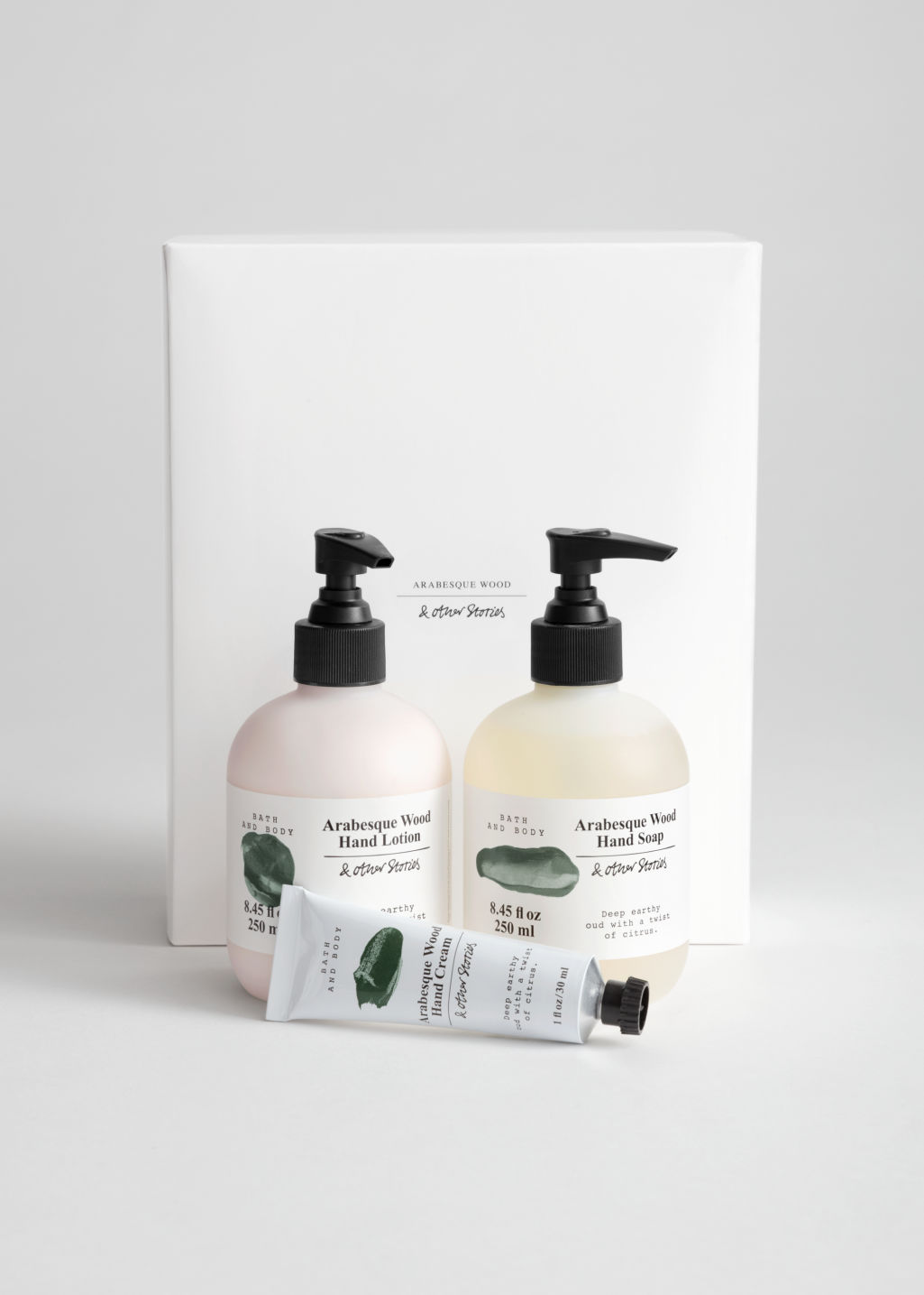 Front image of Stories hand care kit in green