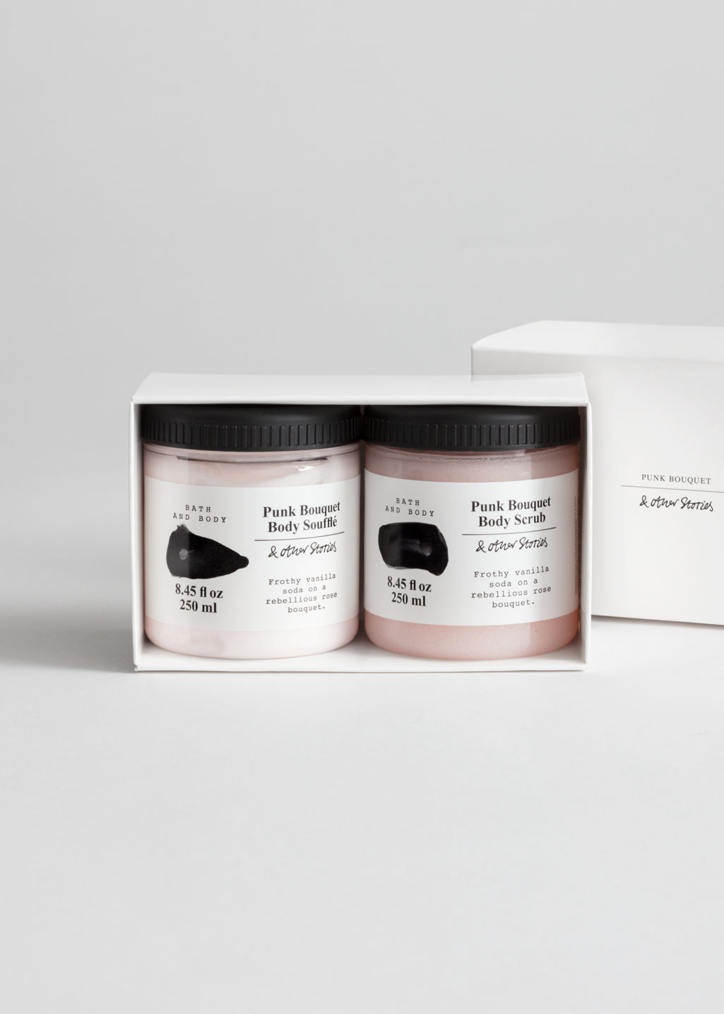 Front image of Stories body care kit in orange