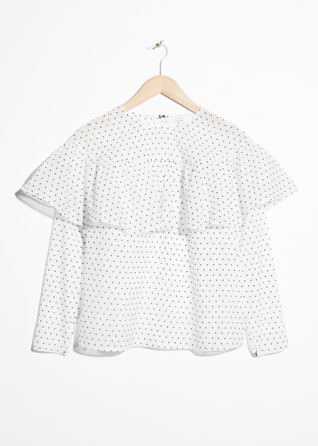 Front image of Stories polka-dot frill blouse in white