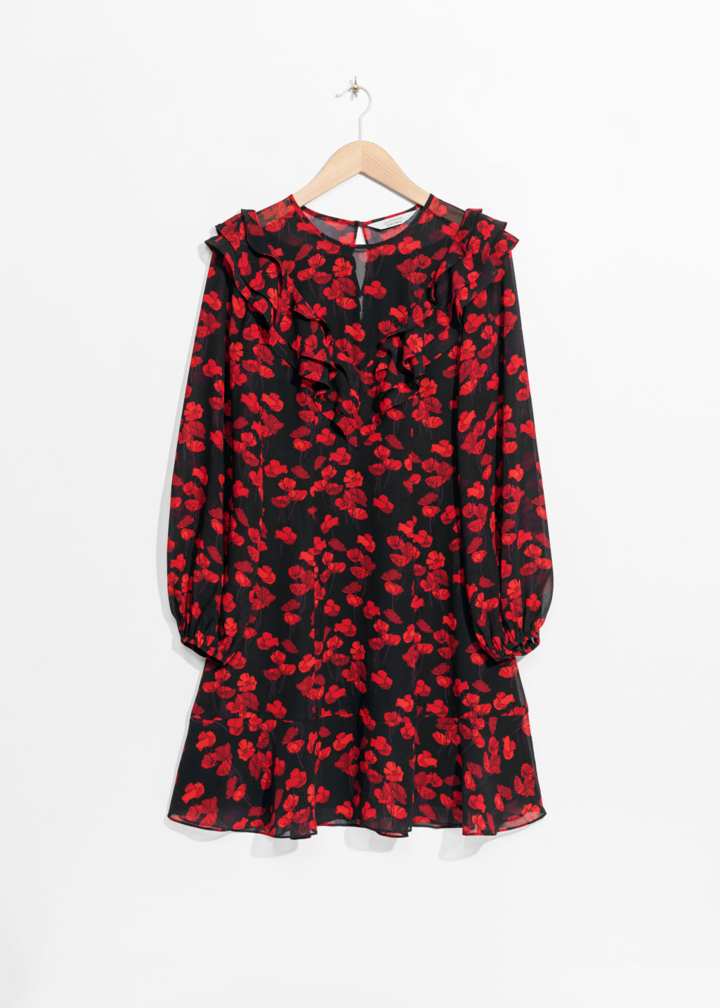 Front image of Stories poppy print dress in black