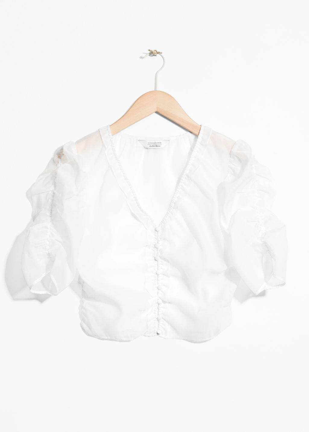 Front image of Stories sheer puff shoulder blouse in white