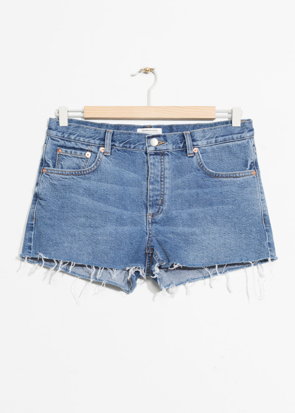 Front image of Stories raw hem jeans shorts in blue