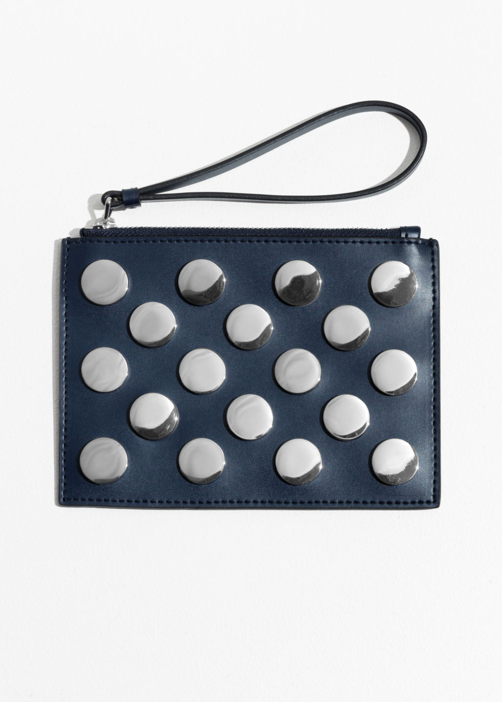 Front image of Stories circle stud leather pouch  in blue