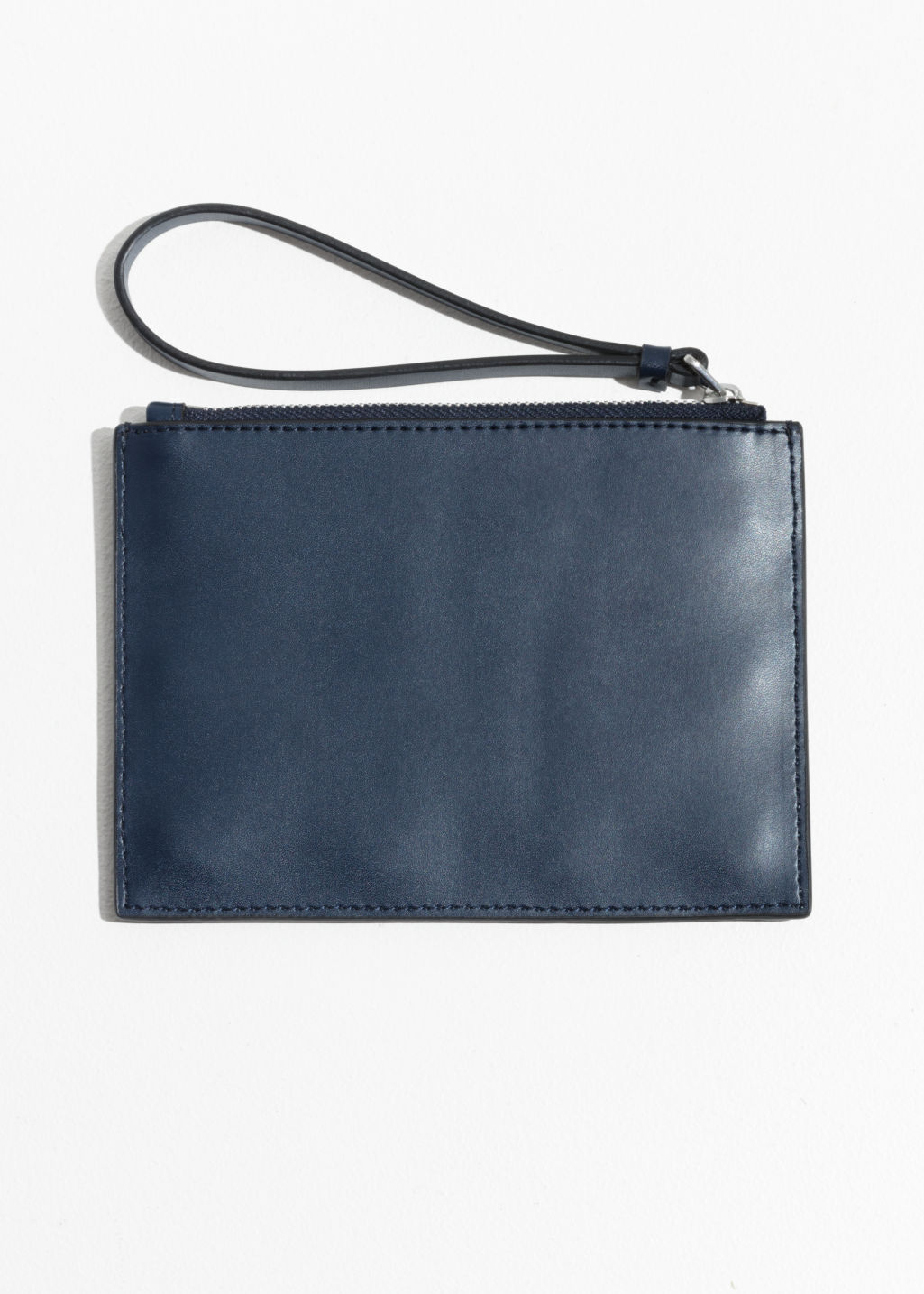 Back image of Stories circle stud leather pouch  in blue