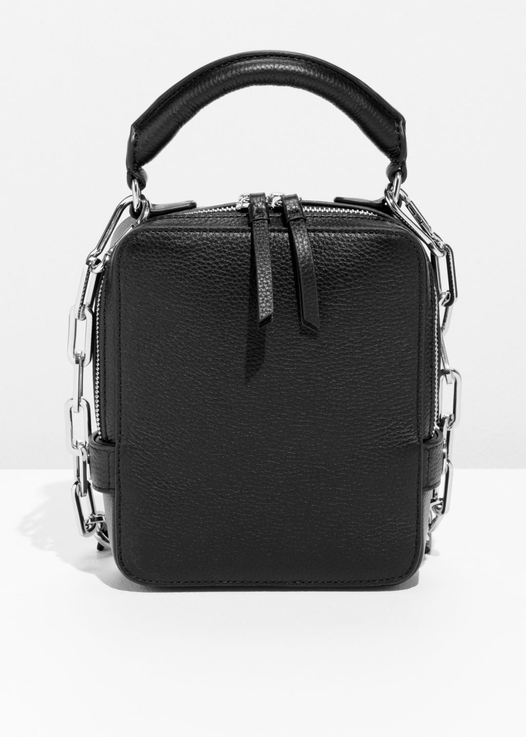 Front image of Stories boxy leather bag in black