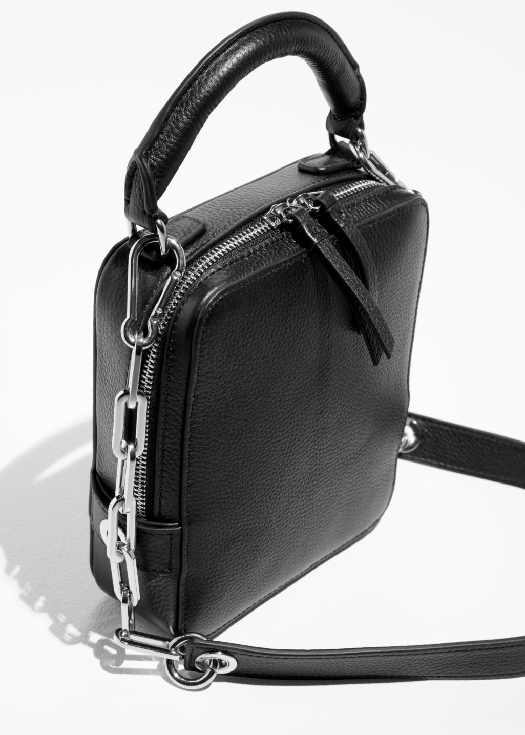 Back image of Stories boxy leather bag in black