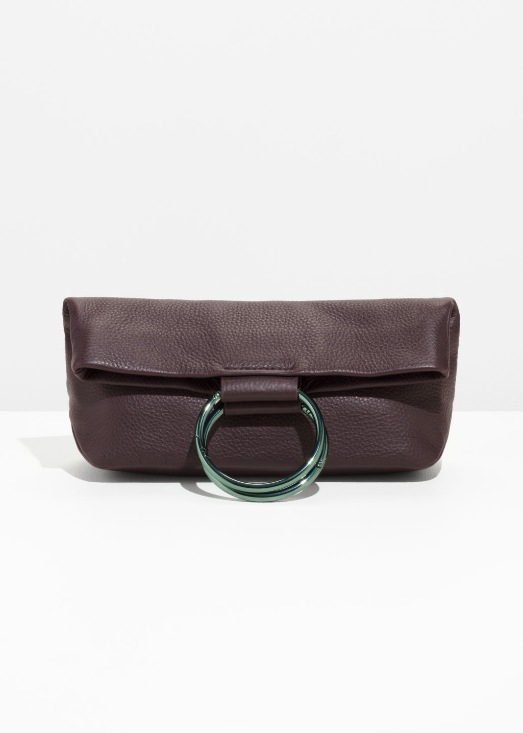 Front image of Stories ring fold-over clutch in red