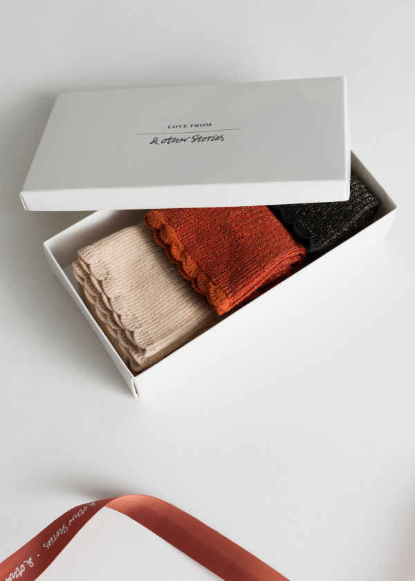Front image of Stories metallic socks gift set in orange