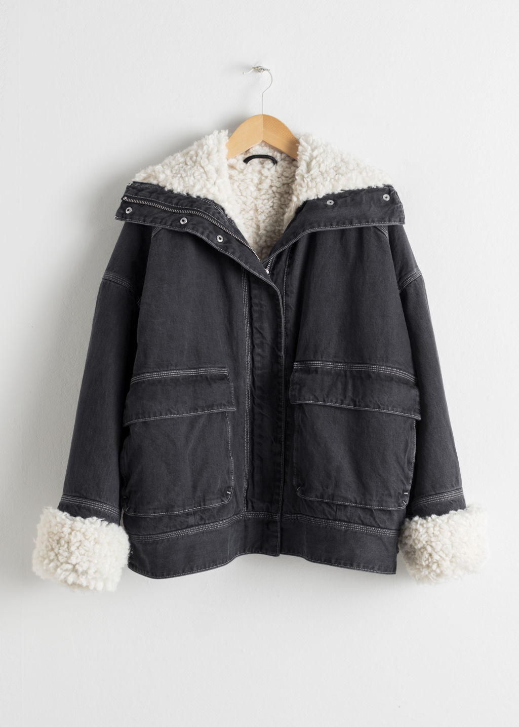 Front image of Stories denim faux shearling jacket in grey