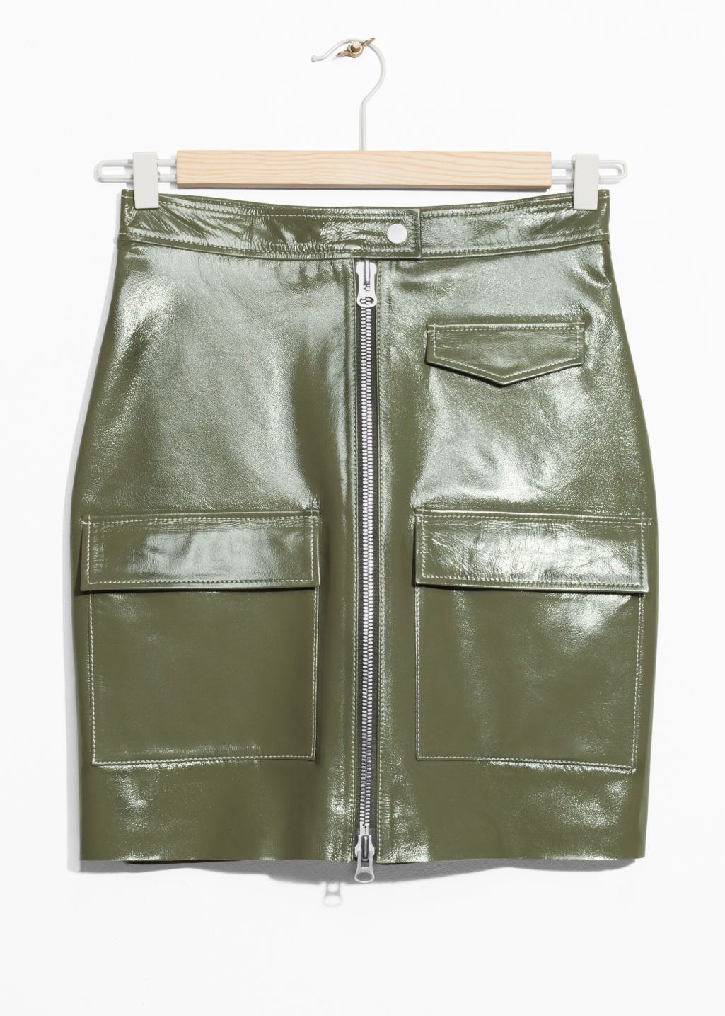 Front image of Stories utilitarian patent leather skirt in green