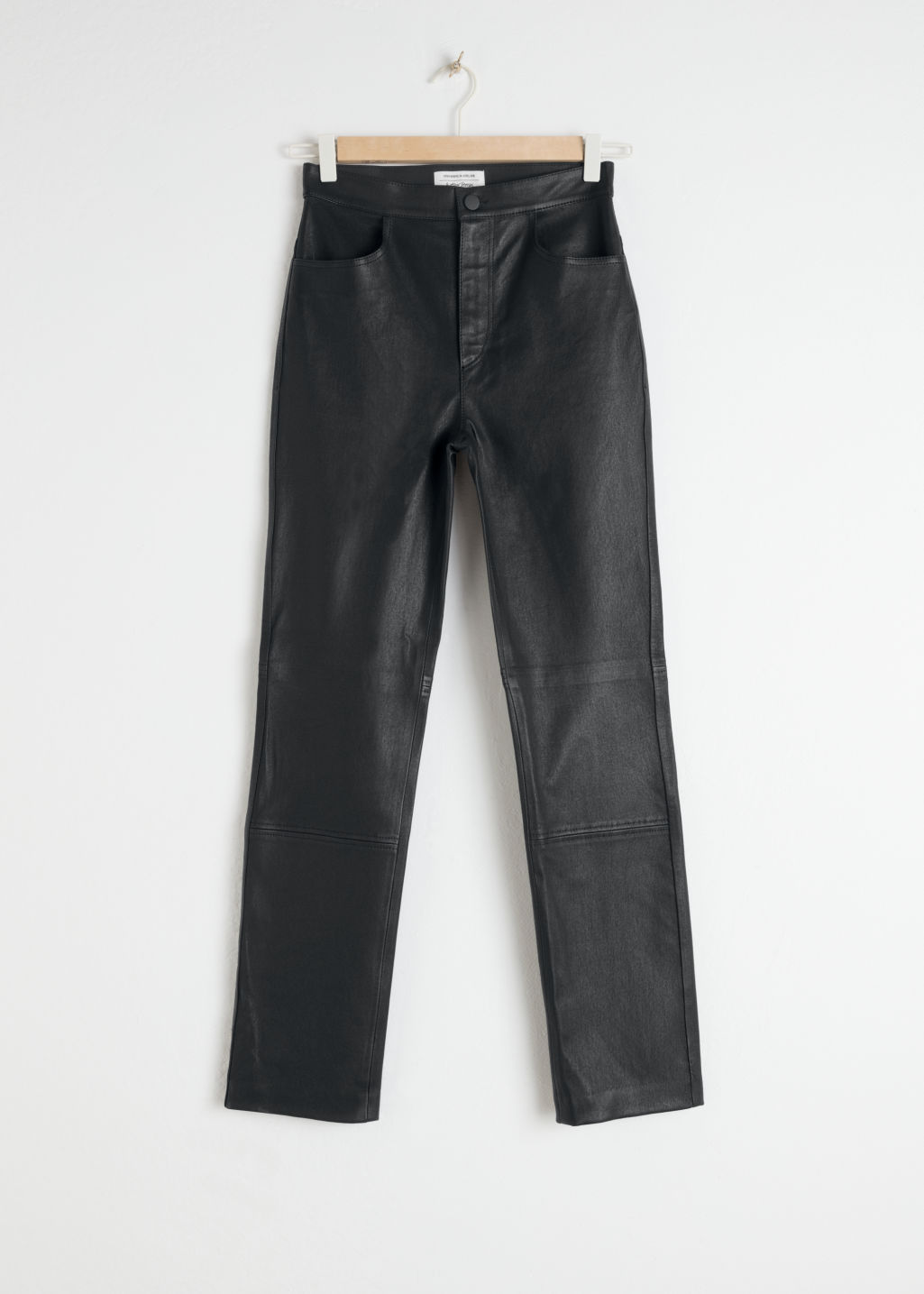 Front image of Stories high waisted leather trousers in black
