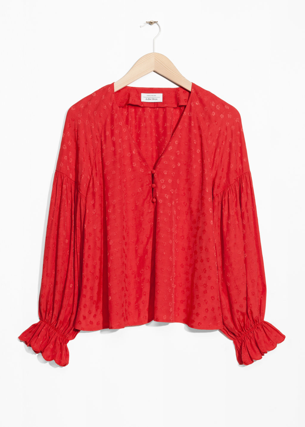 Front image of Stories v-neck blouse with trumpet sleeves in red