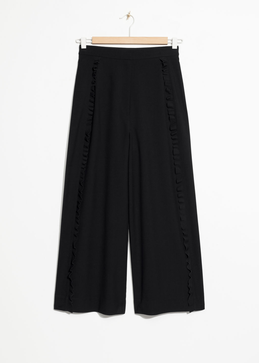 Front image of Stories ruffle tuxedo stripe culottes  in black