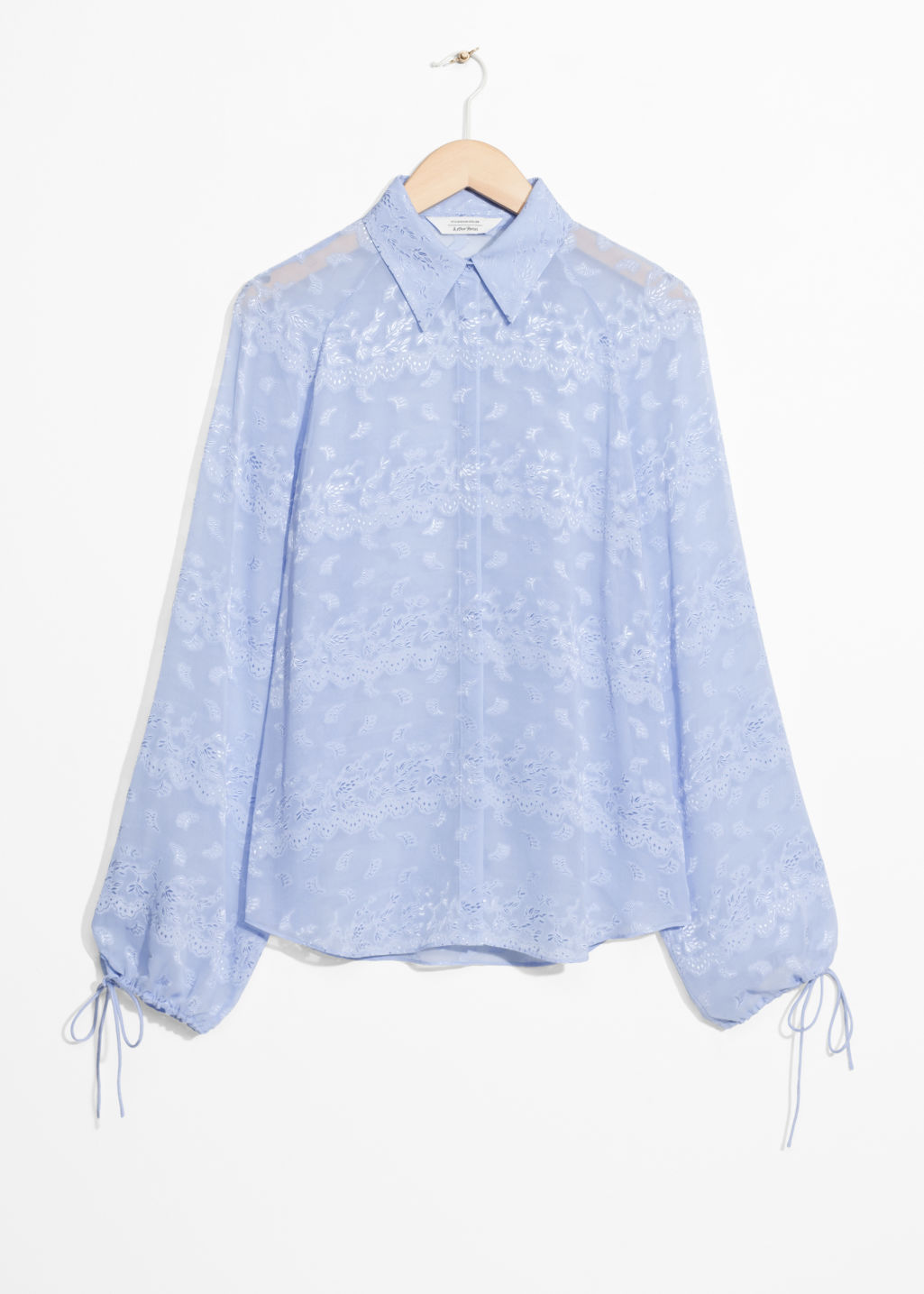 Front image of Stories billowy jacquard blouse in blue
