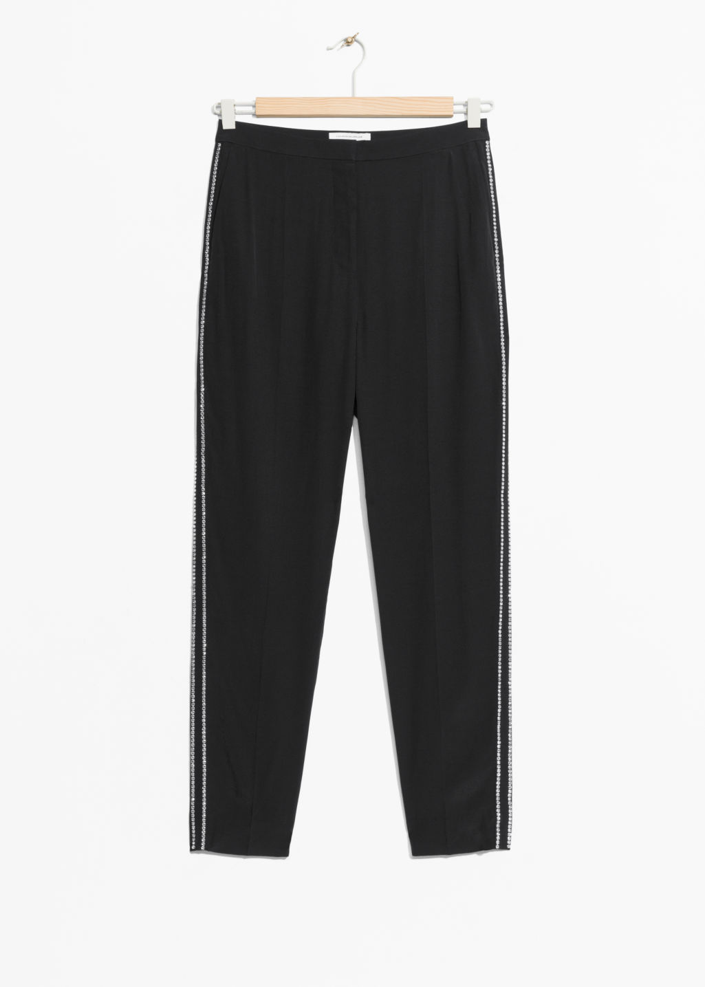 Front image of Stories rhinestone trim trousers in black