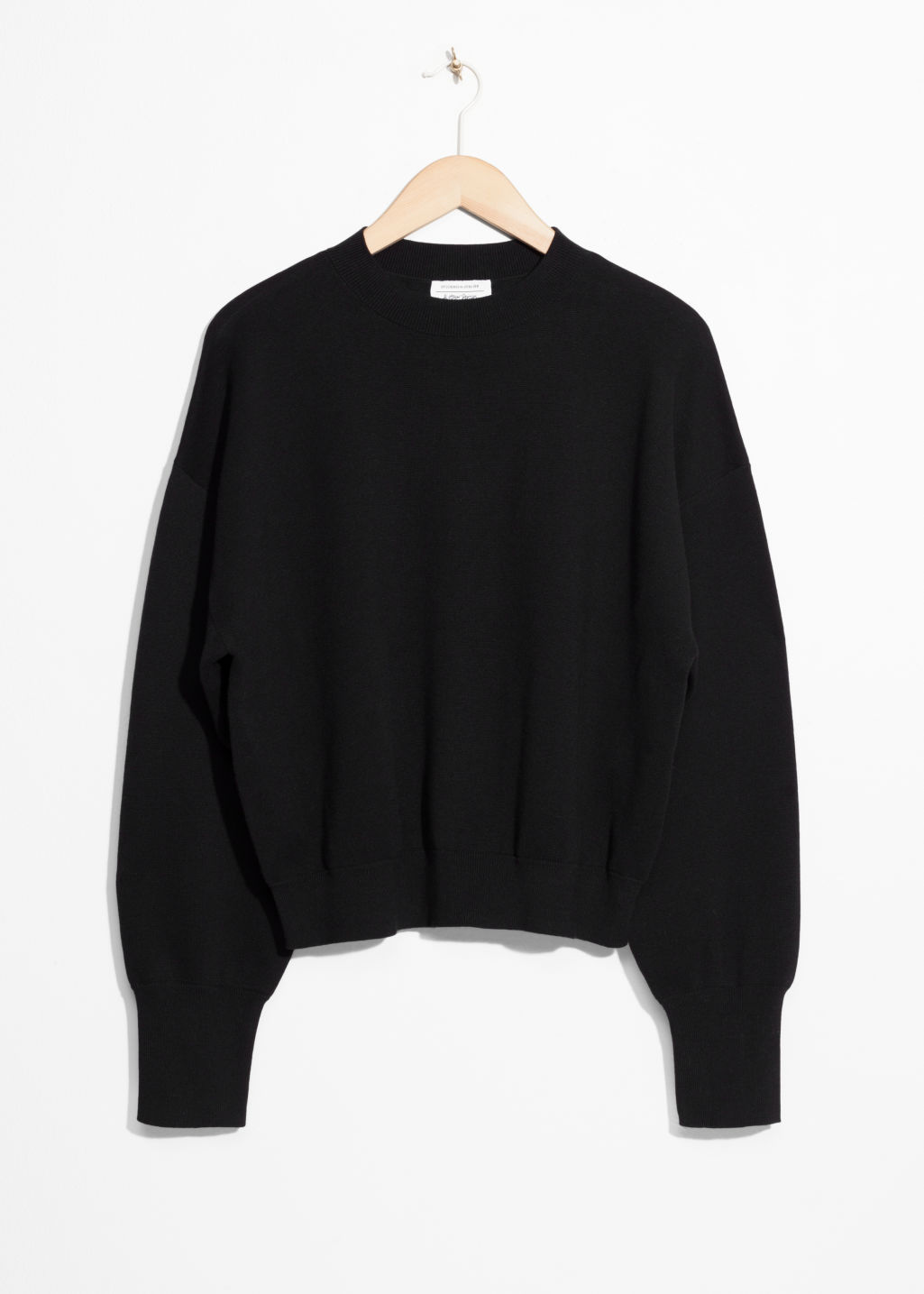 Front image of Stories cropped knit sweater in black