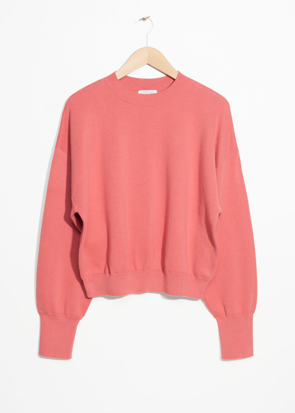 Front image of Stories cropped knit sweater in pink