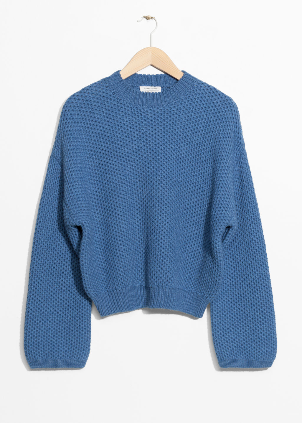 Front image of Stories cropped honeycomb knit sweater  in blue