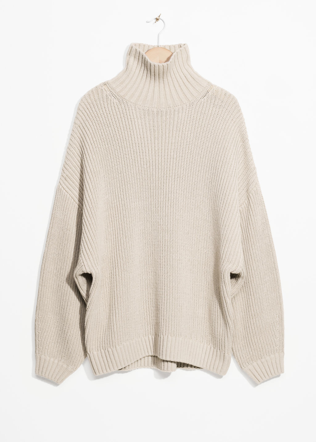 Front image of Stories jumbo turtleneck sweater in beige
