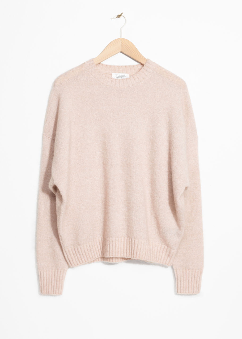 Front image of Stories wool blend sweater in pink
