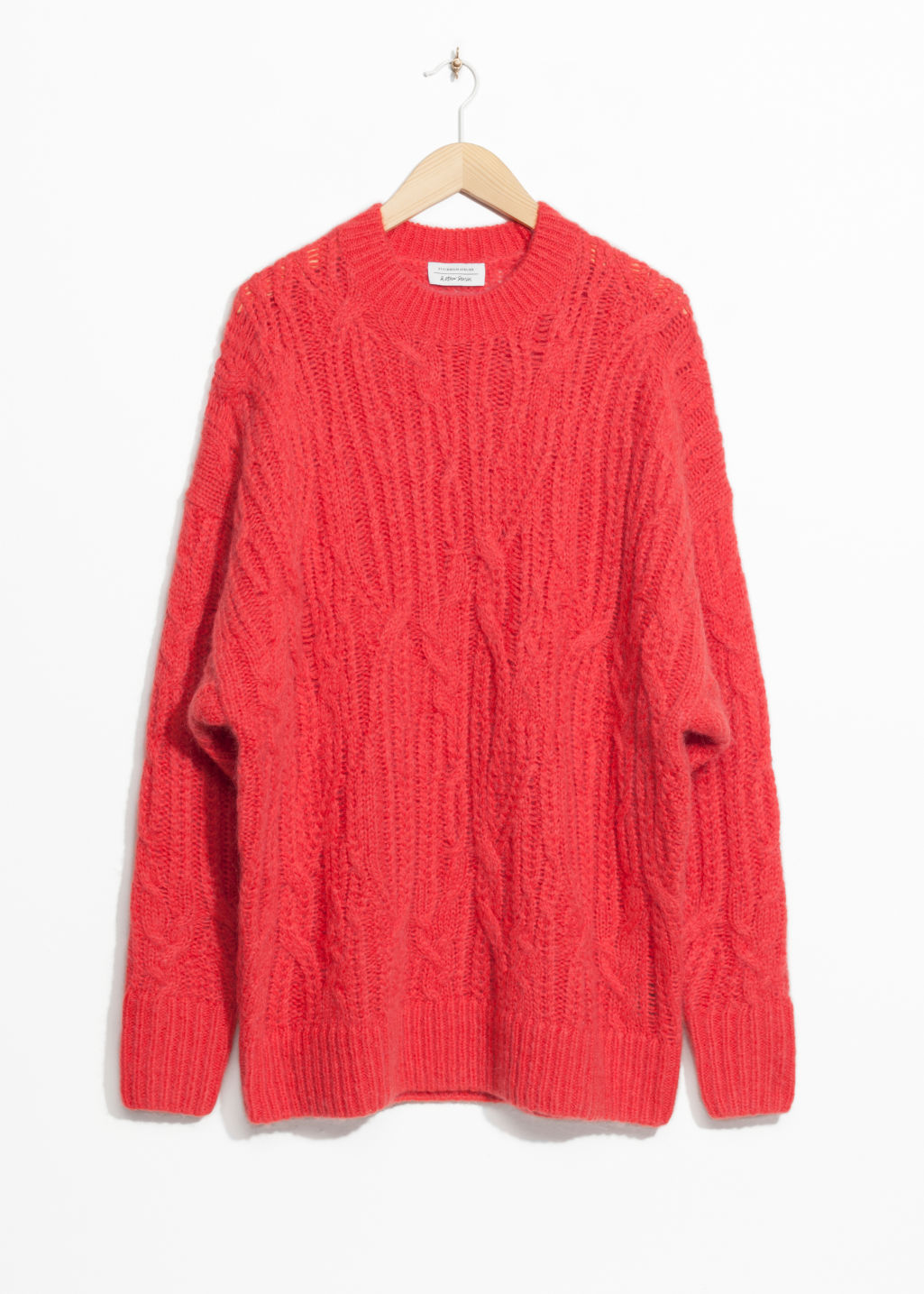 Front image of Stories oversized cable knit sweater in orange