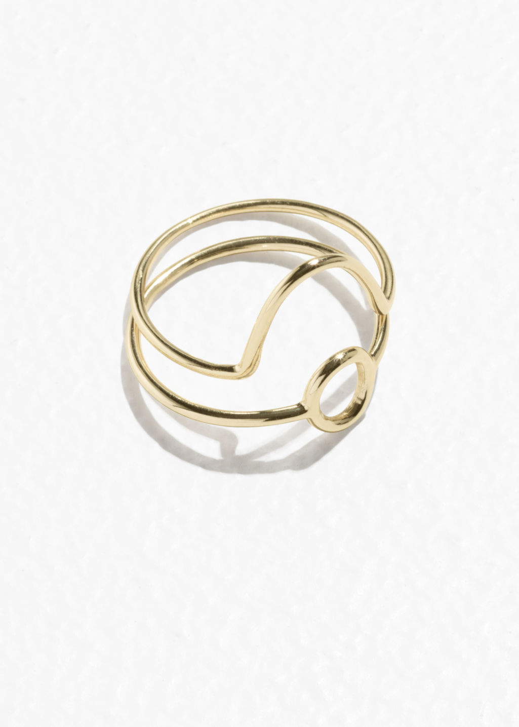 Front image of Stories round stack ring set in gold