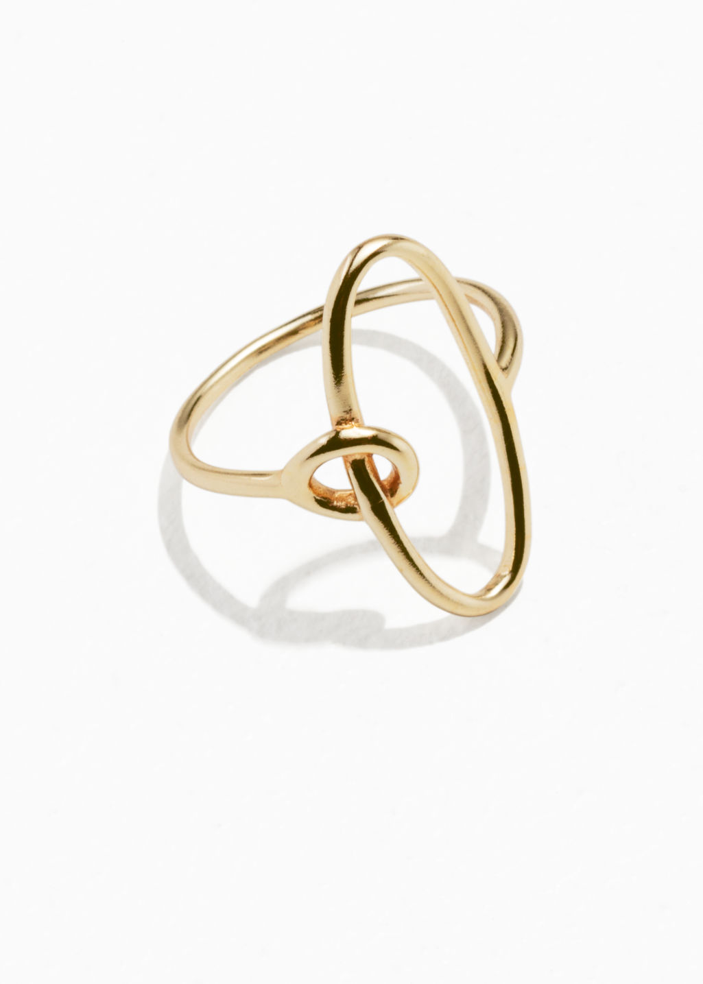 Front image of Stories oval loop ring  in gold