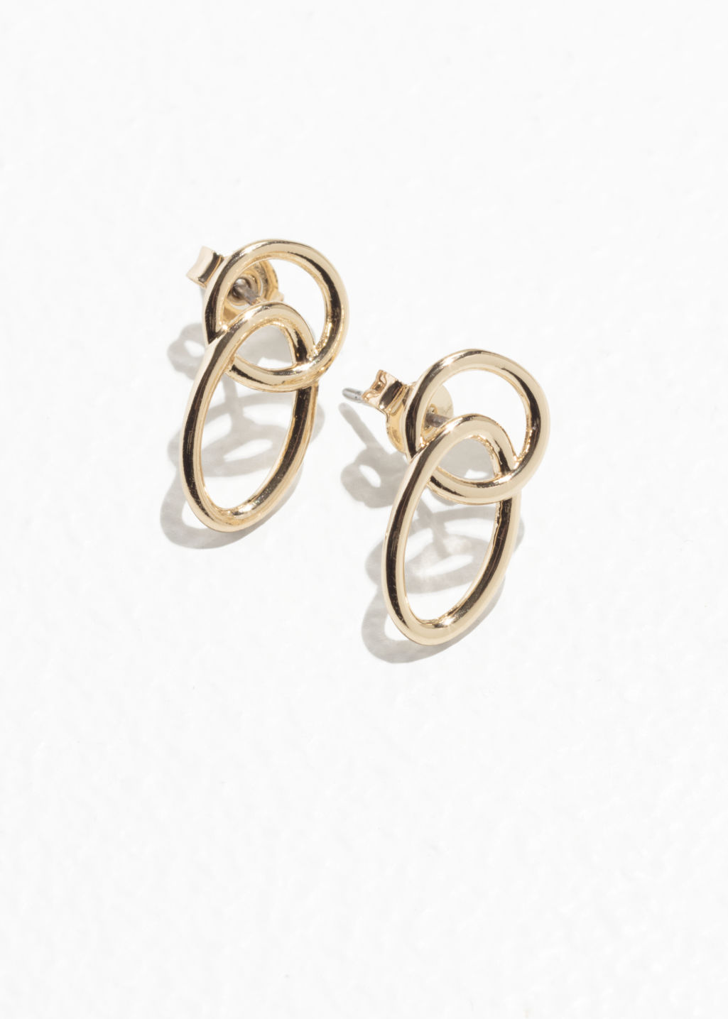 Front image of Stories duo ring earrings in gold